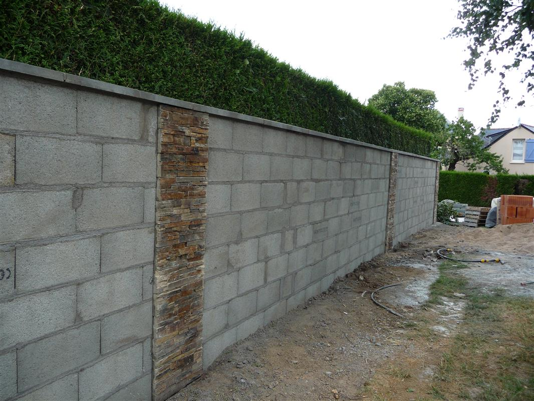 Mur de s paration les r alisations d 39 isolation par l for Mur de separation terrasse